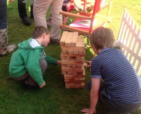 two boys playing jenga