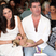 Image 5: Lauren Silverman & Simon Cowell with a dog