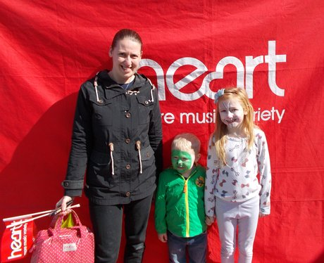 family outside heart tent