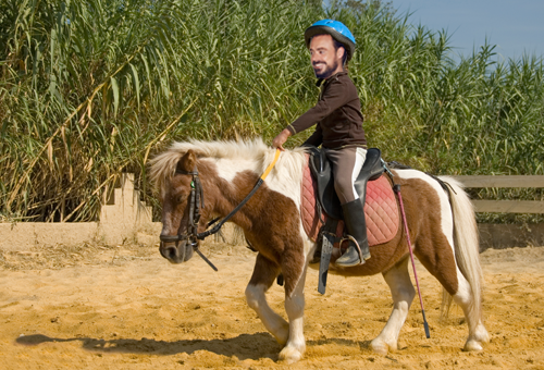 Jamie on a pony