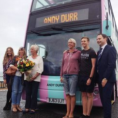 Andy Durr family outside bus