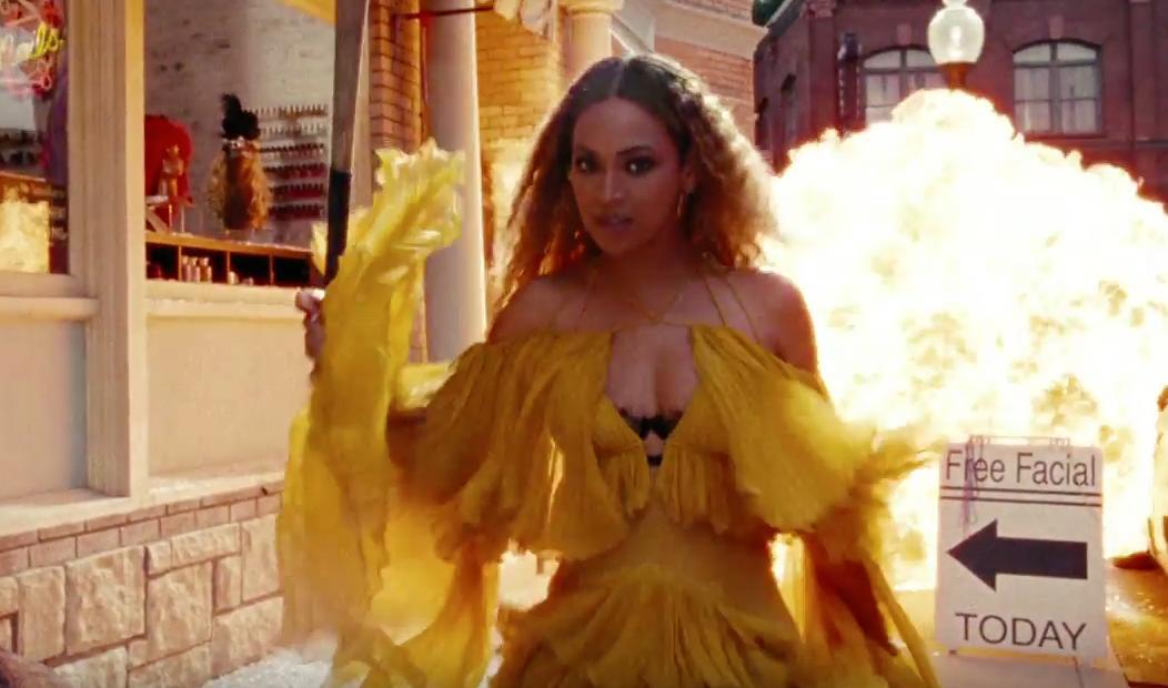 Beyonce holding baseball bat