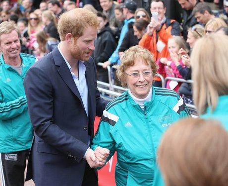 Prince Harry helps Sylvia Disley when she trips