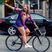 Image 3: Model Ashley Graham on a bike