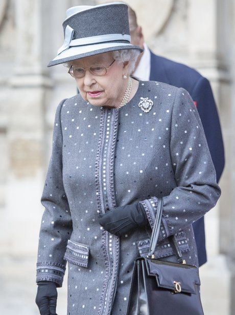 Queen Elizabeth II in a a grey spotty coat