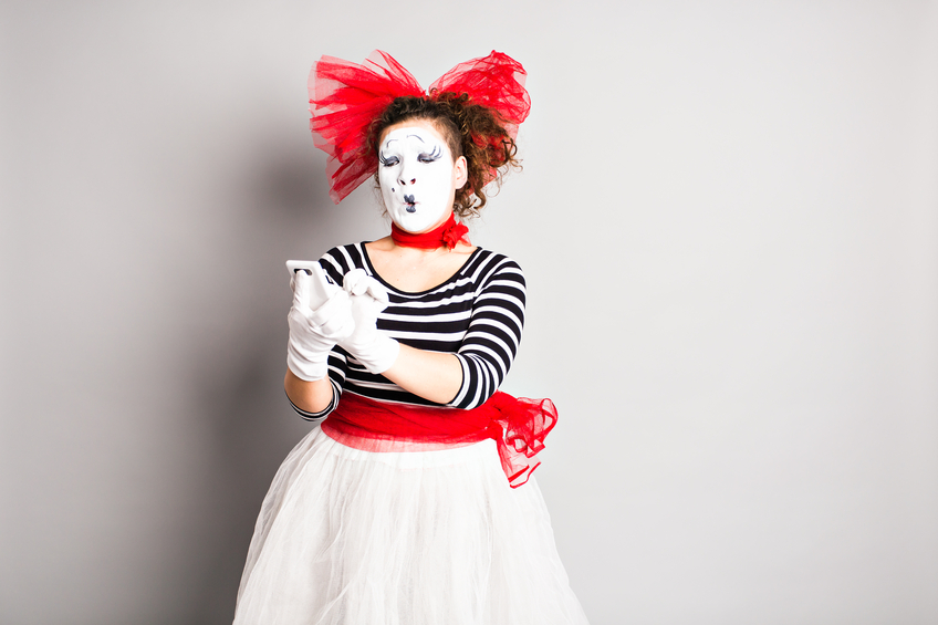Lady in clown outfit texting