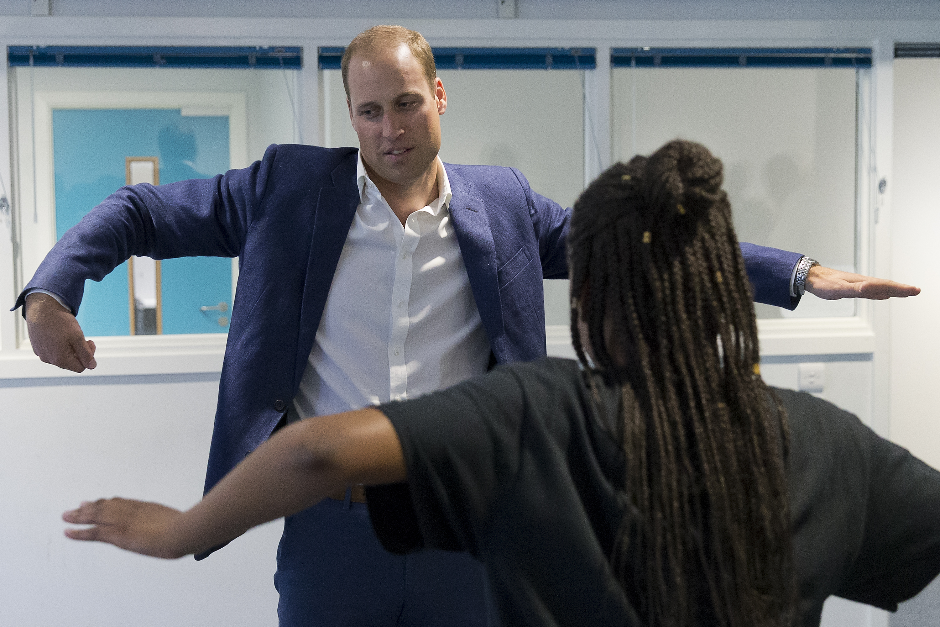 Prince William dancing at a royal visit