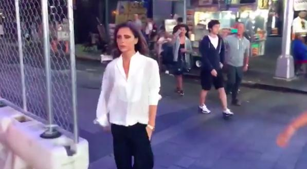 Victoria Beckham poses while dancing in Times Squa