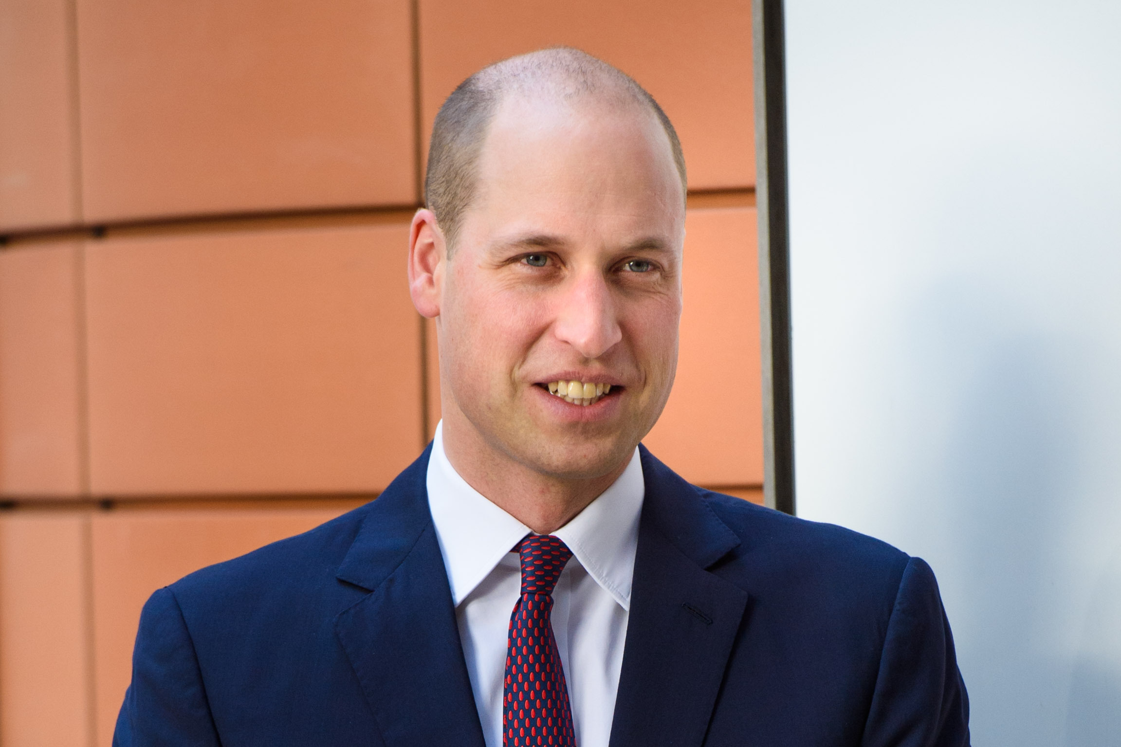 Prince William sports shaved head on royal visit