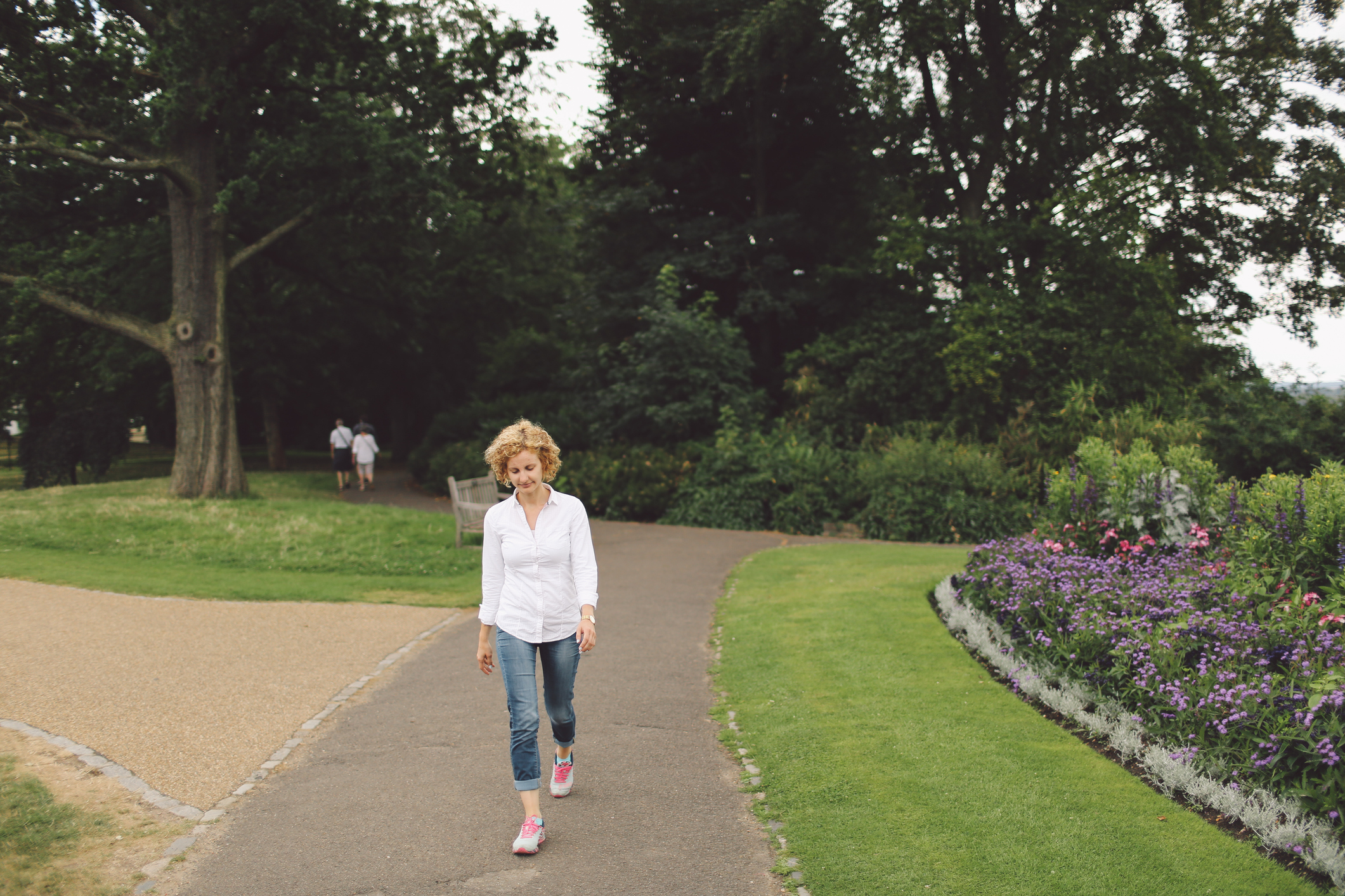 Lady walking through the park