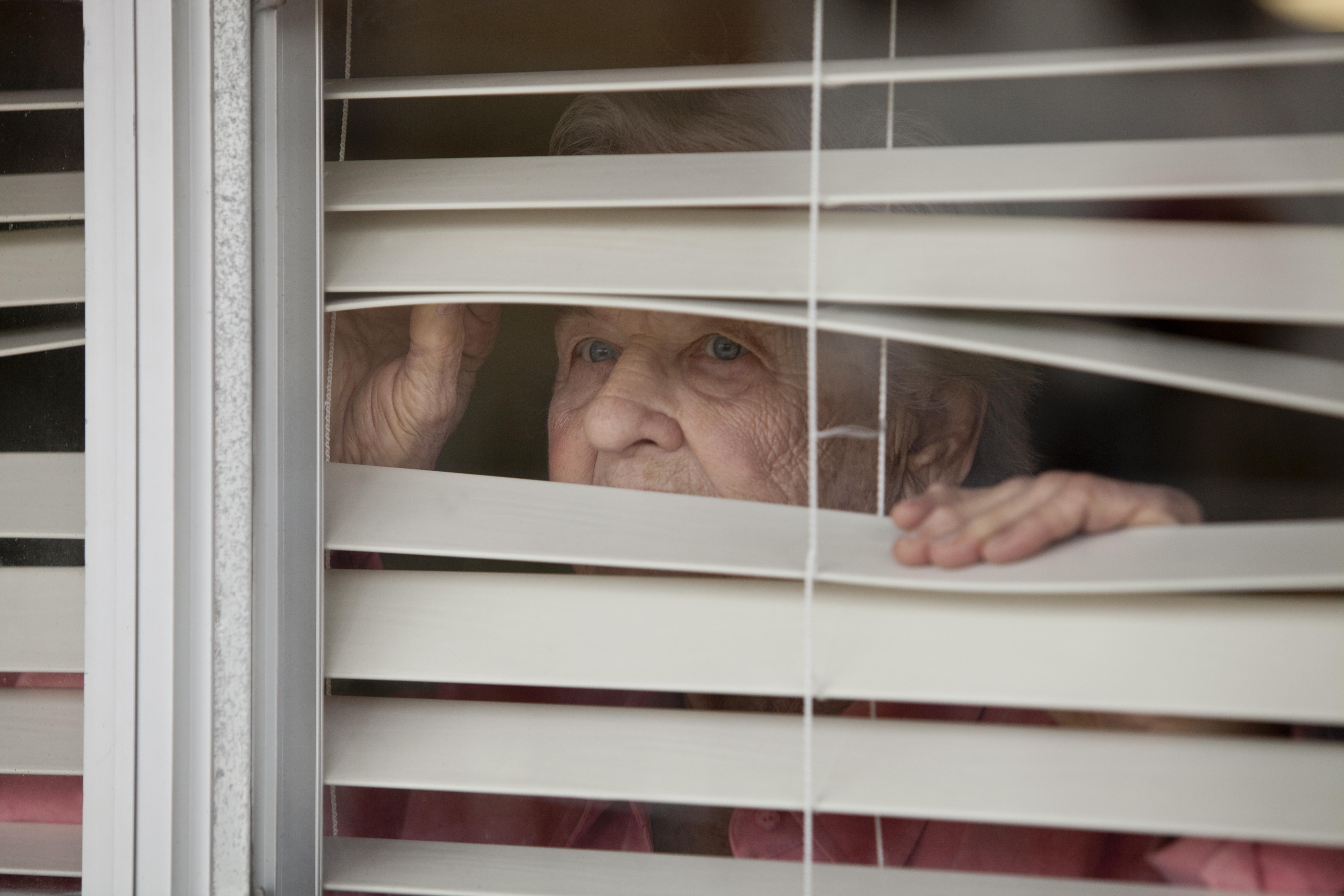 Neighbour looking through blinds