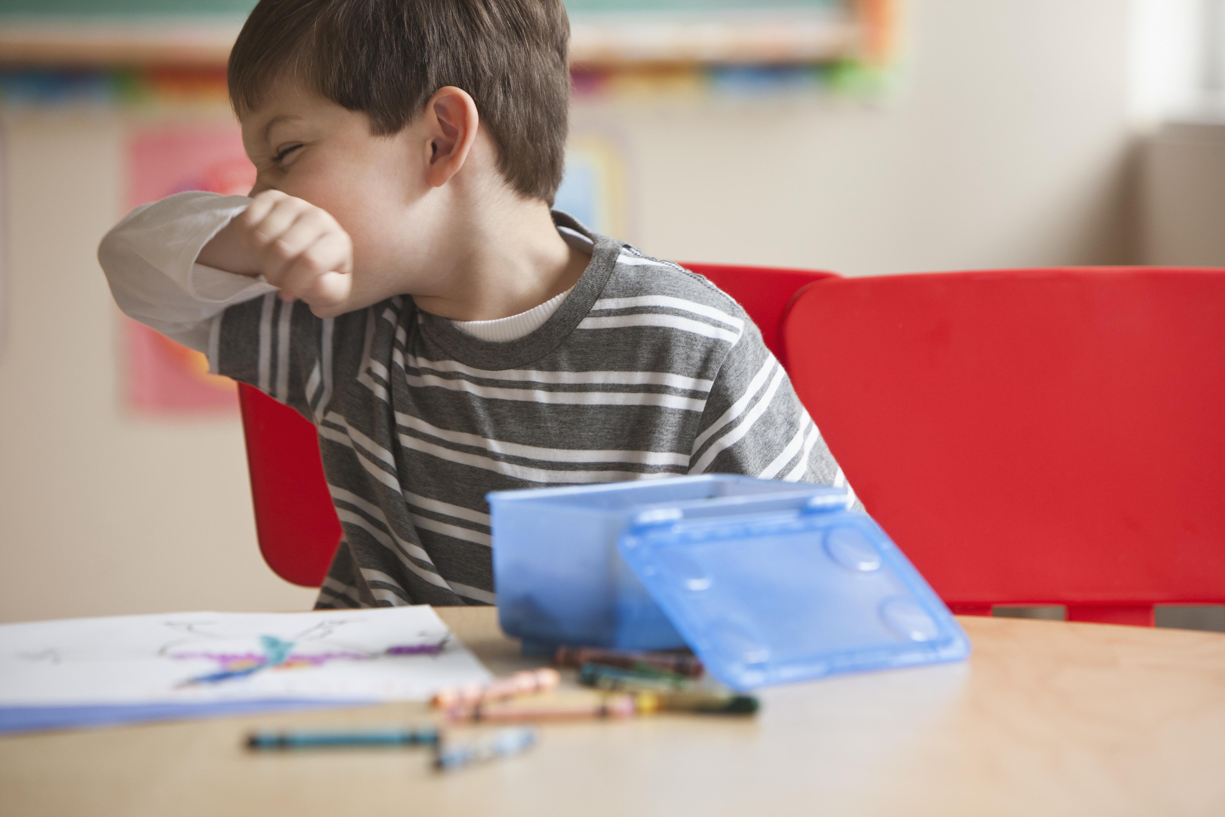 Kids blowing nose