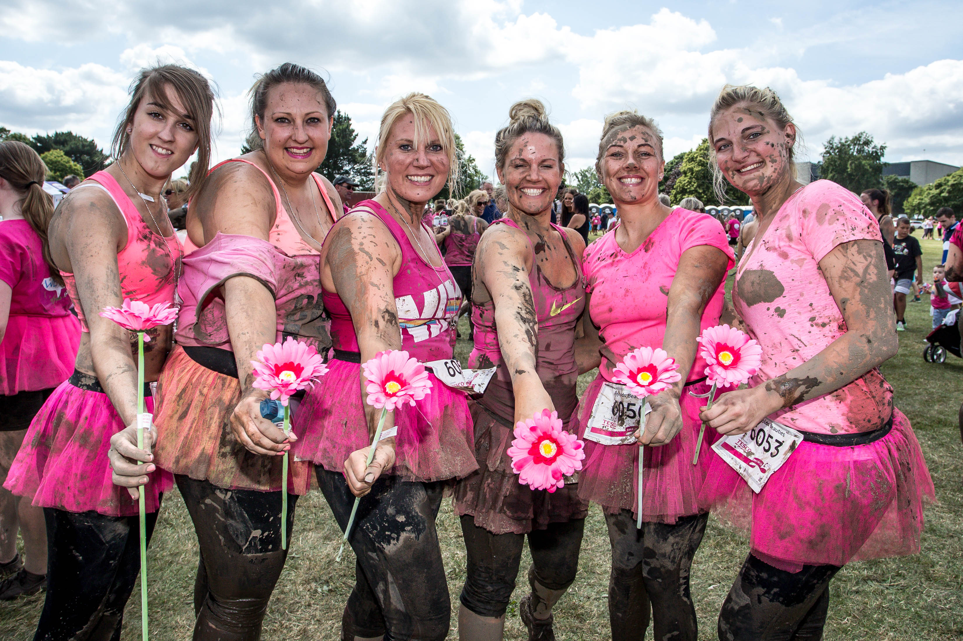 6 Race for Life Ladies Holding Flowers