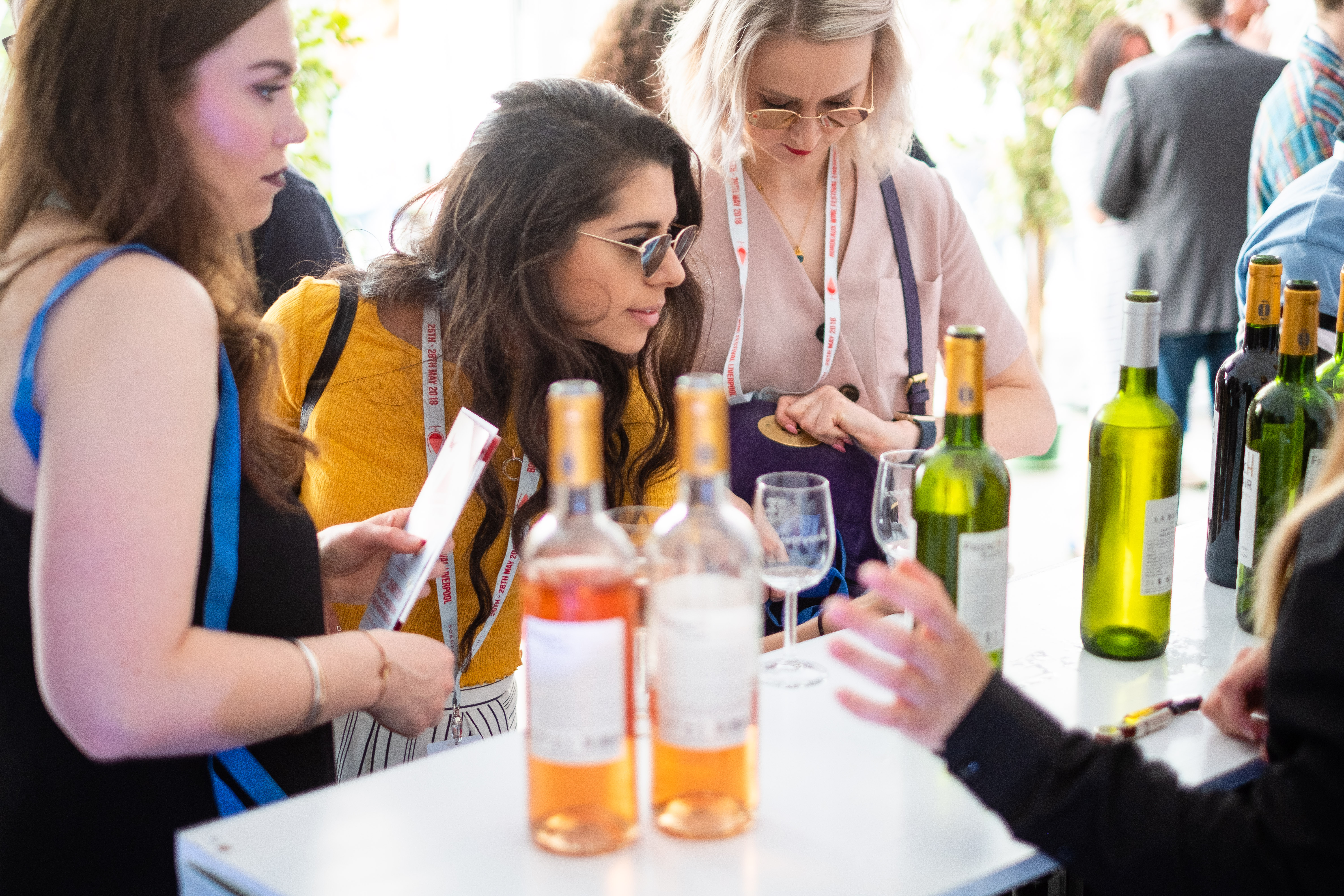 Girls looking at wine