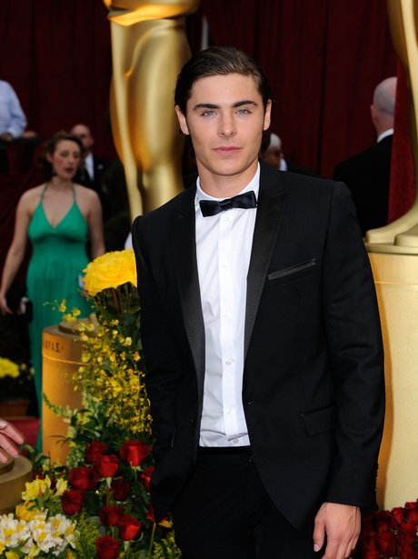 Heart throb Zac Efron looks dashing in a tuxedo and bow tie