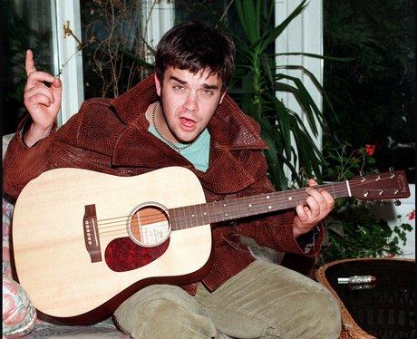 Robbie Williams on his guitar