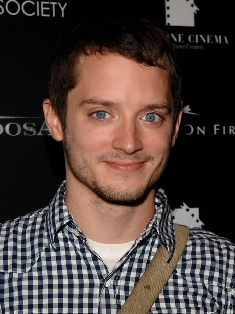 Elijah Wood in a checked shirt