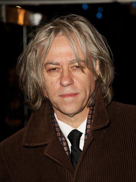 Sir Bob Geldof wearing brown coat