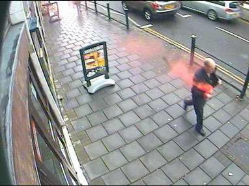 Suspect covered in red dye on High Street