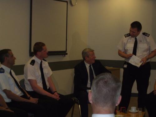 Alan Johnson speaks to local police