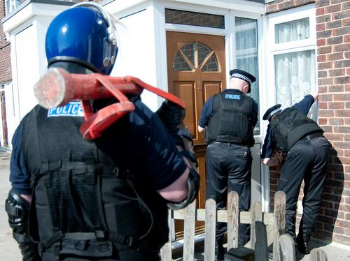Mid Kent Police carrying out a raid