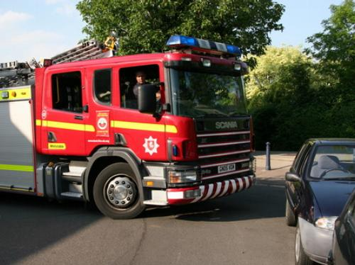 A fire engine struggles to get along a road