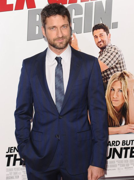Gerard Butler wows in a navy blue sit at a premiere