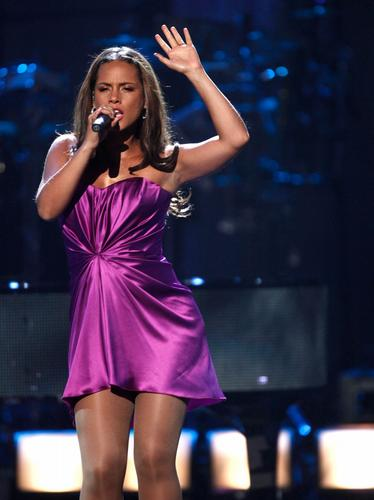 Alicia Keys performing on stage