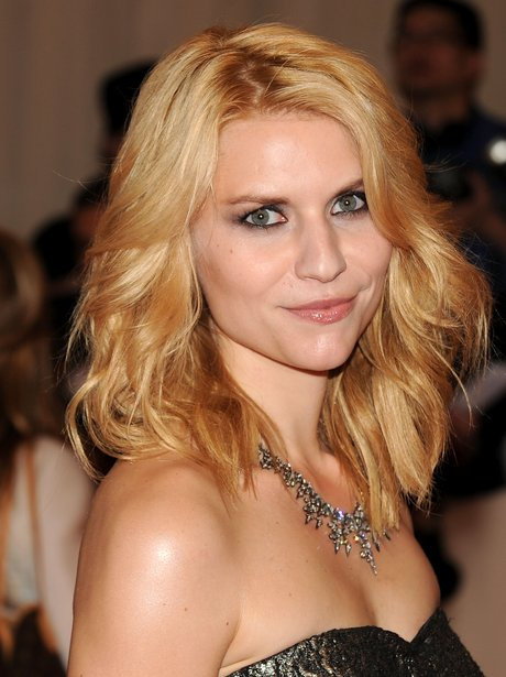 Claire Danes with blonde toussled waves on red carpet