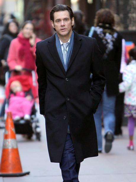 Jim Carrey walking down a street