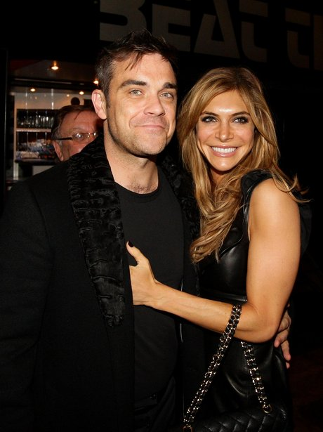 Robbie Williams and Ayde Field smile for the cameras
