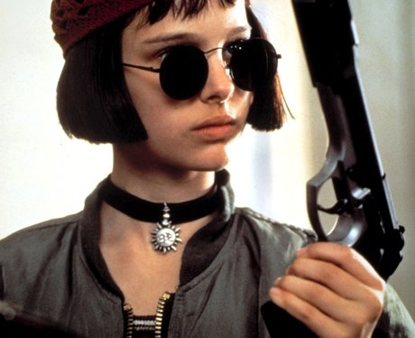 a young natalie portman in 'leon' with round glasses