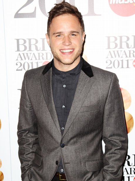 Olly Murs looks cute and sexy in a grey suit at The Brit Awards.