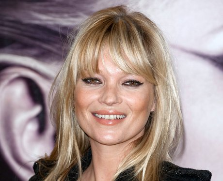 Kate Moss on red carpet with blonde fringe
