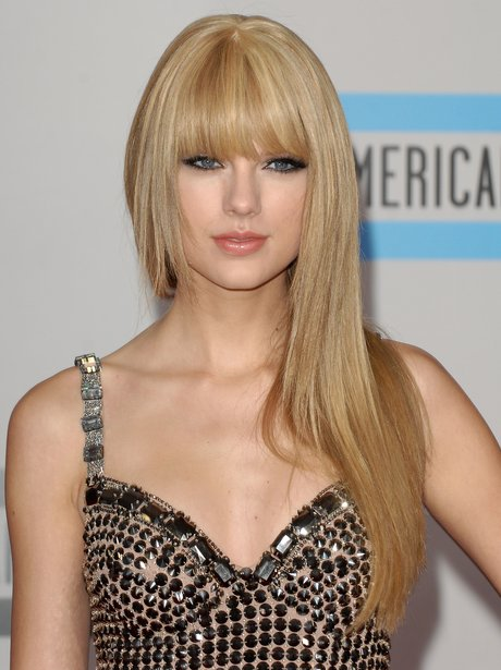 Taylor Swift in a gold dress