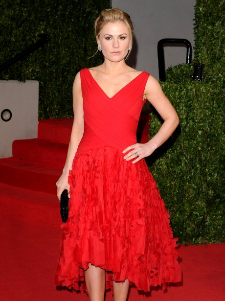 Anna Paquin in a red dress