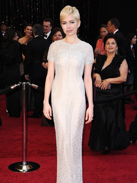 Michelle Williams in a white dress on the red carpet
