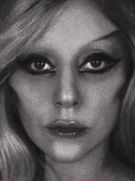 A black and white photograph of Lady Gaga with eye liner on