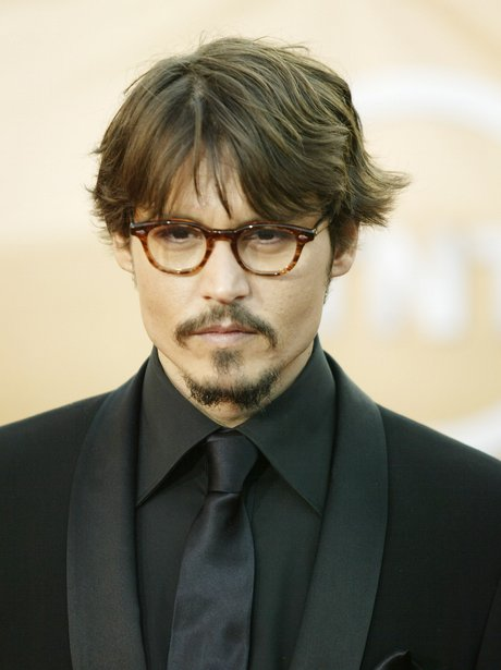 Johnny Depp is handsome in glasses and a black suit