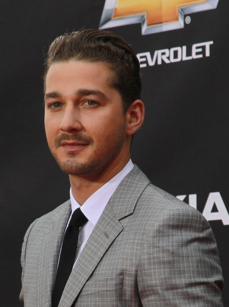 Shia LaBeouf as a grown man in a grey suit