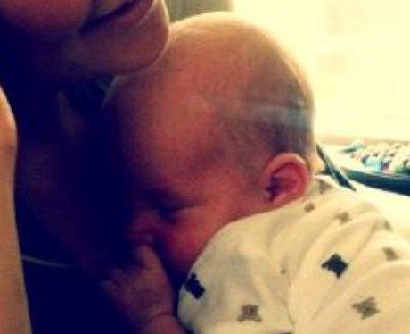 Kate Hudson cuddles baby Bingham