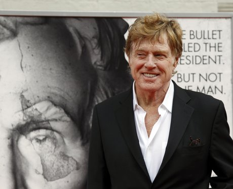 robert redford in a white shirt and jacket