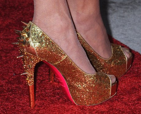 gold Louboutins with spikes