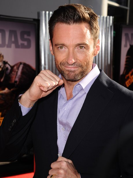 Hugh Jackman strikes a pose on the red carpet