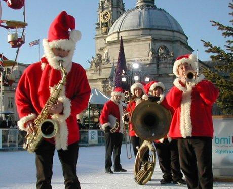 A band dressed as Santas