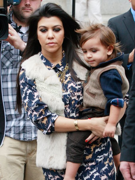 Mason Disick and Kourtney Kardashian walking down street
