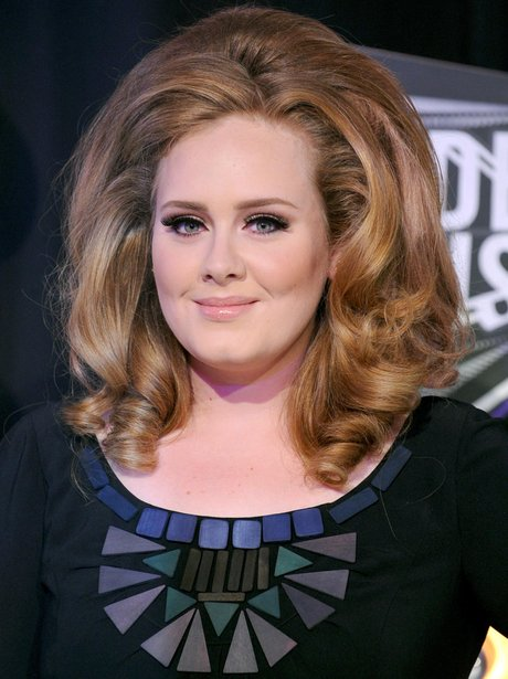 Adele with big hair on red carpet