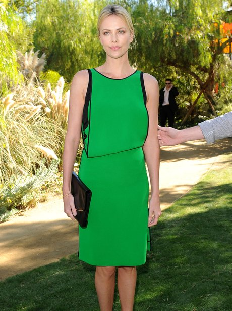 Charlize Theron arrives at a Film Festival