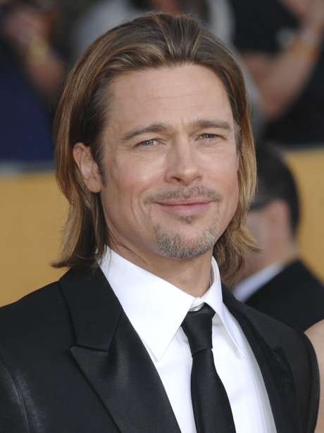 The classically good looking Brad Pitt looks hot with long hair