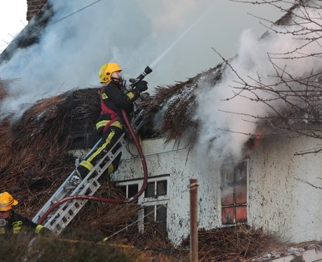 More than 100 tackle cottage fire